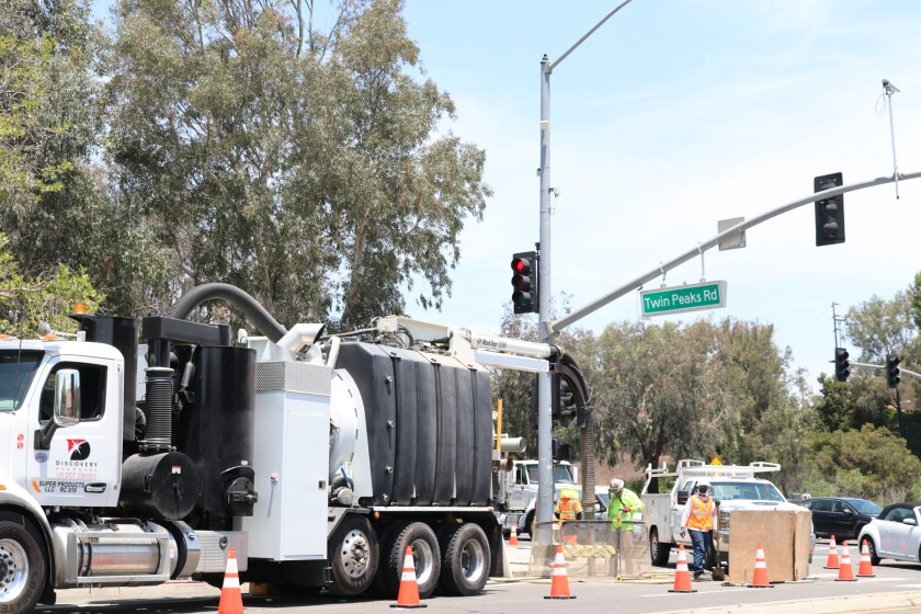 A crew working on San Diego Gas & Electric's natural gas pipeline replacement project on Pomerado Road at Twin Peaks Road.
