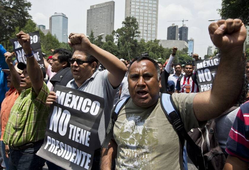 Teachers protest and block highways to protest e education reform legislation, in Mexico City on Wednesday.