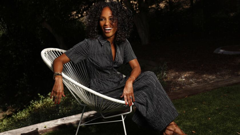 """Showrunner Mara Brock Akil relaxes at her home in Beverly Hills on June 13, 2018. Mara and her husband, Salim Akil, created and produced the upcoming OWN television series """"Love Is_."""""""