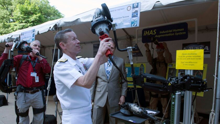Vice Adm. Ted Branch is briefed on new military technology as he tours exhibits at the Pentagon in 2015.