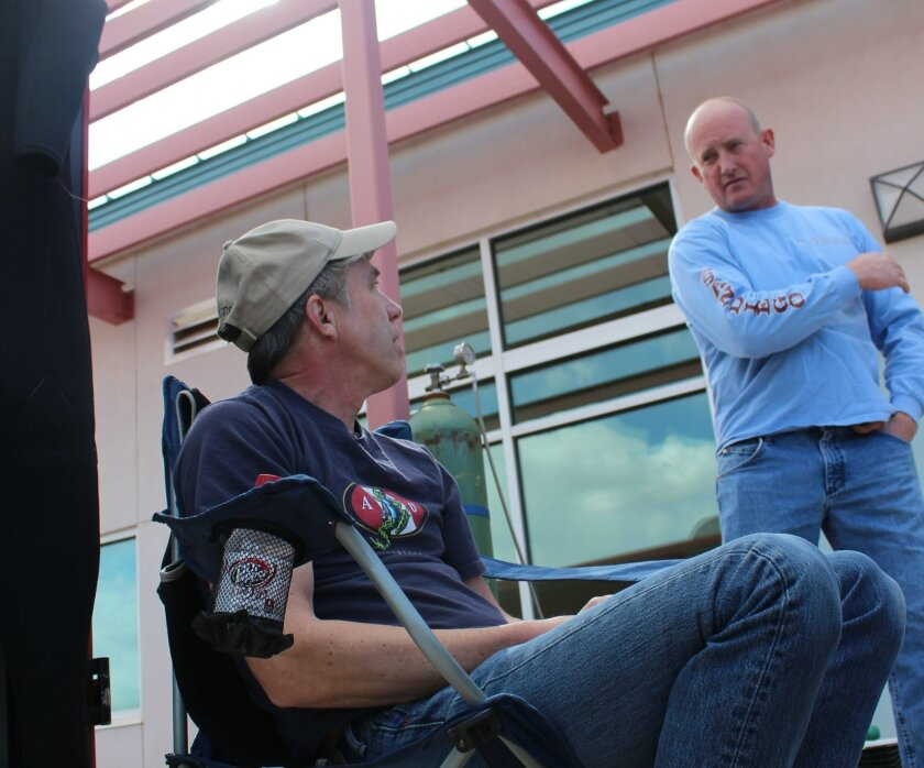 Shane Thompson, right, talks to fellow diver Mike Young, on the day before Thompson was killed in a diving accident in New Mexico.
