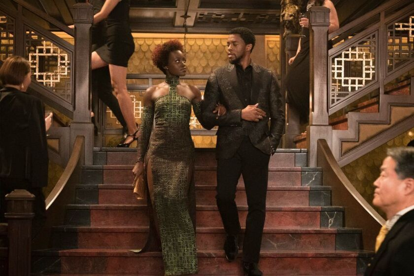 """Lupita Nyong'o and Chadwick Boseman in """"Black Panther,"""" which goes beyond superhero conventions to defy genre and emerge as a film that is both deeply personal and highly entertaining."""