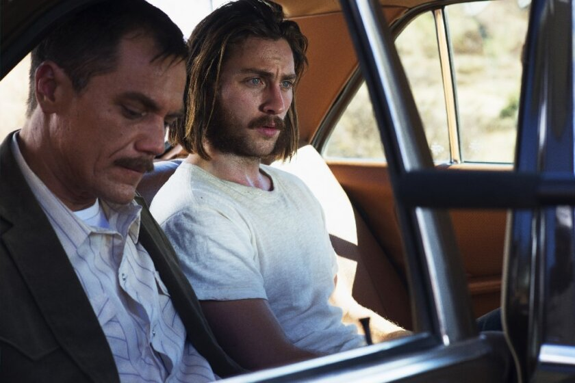 "Michael Shannon and Aaron Taylor-Johnson in ""Nocturnal Animals."""