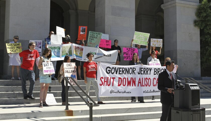 Adam Scow, California director of the advocacy organization Food & Water Watch, speaks at a rally Wednesday, Aug. 3, 2016, in front of the state Capitol in Sacramento, Calif., to urge Gov. Jerry Brown to permanently close the Aliso Canyon gas storage facility. A 16-week gas leak at the facility tha