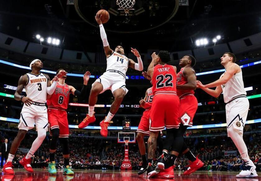 Gary Harris (c) de los Nuggets en acción hoy, miércoles 31 de octubre de 2018, durante un partido de baloncesto de la NBA entre Denver Nuggets y Chicago Bulls, en el United Center de la ciudad de Chicago, Illinois (EE.UU.). October 2018. EFE