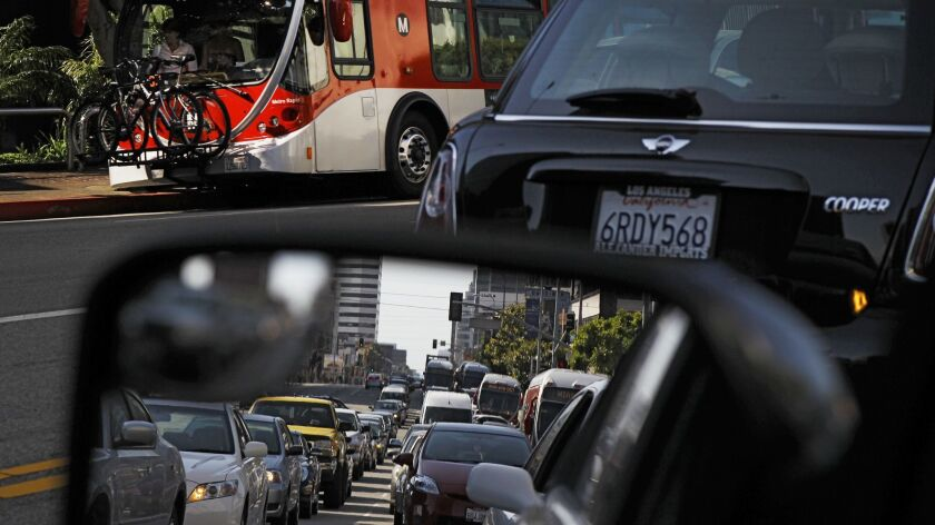 Buses get stuck in traffic on Wilshire Boulevard even when its peak-hour bus-only lane is in effect. The bus-only lanes get choked with motorists who break the rules.