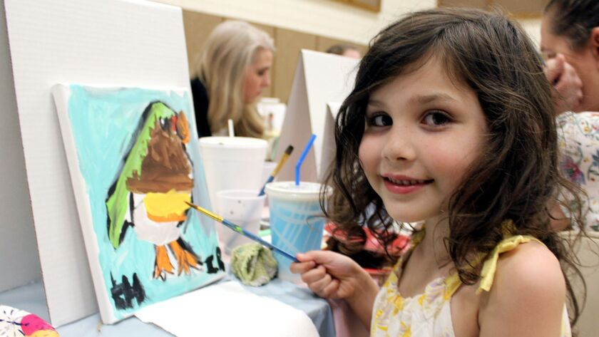 Kiana Hughes, 6, takes a photo break from her artistic endeavors. (Photo by Ruth Sowby Rands)