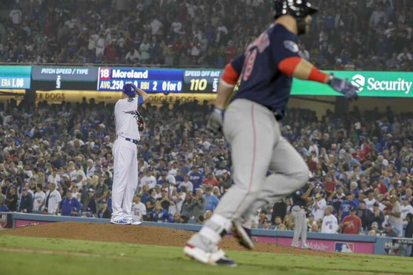 Dodgers reliever Ryan Madson wipes sweat from his brow as Boston Red Sox's Mitch Moreland rounds the bases on a three-run seventh inning homer.