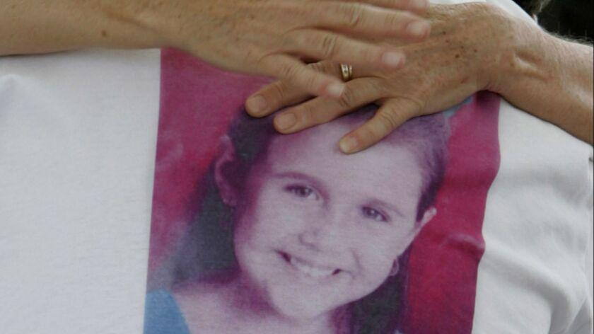 Isabel Celis' image adorns her father's T-shirt in April 2012.