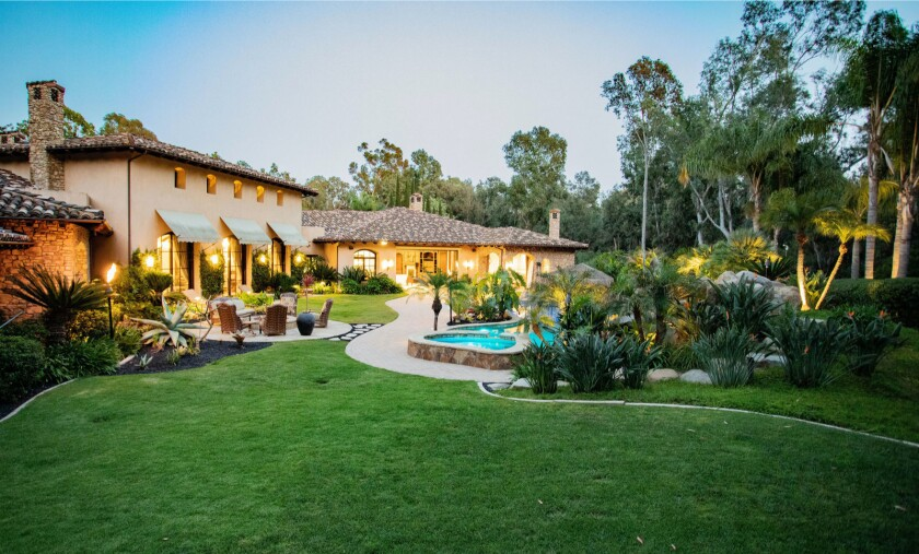 The property holds a 10,000-square-foot home with a resort-style backyard.