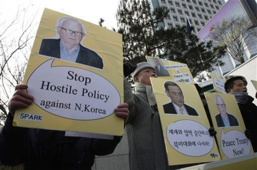 South Korean protesters with portraits of U.S. special envoy on North Korea, Stephen Bosworth shout slogans during a rally against the United States and South Korean government's policies on North Korea in front of the Foreign Ministry in Seoul, South Korea, Wednesday, Jan. 5, 2011. Bosworth arrived Monday to discuss ways to deal with North Korea amid lingering tension following the North's artillery attack on a front-line island that killed four South Koreans in last year's November.(AP Photo/Ahn Young-joon)