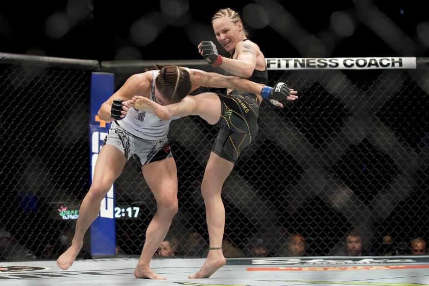 Valentina Shevchenko, right, kicks Lauren Murphy during a women's flyweight.