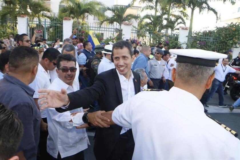 Venezuelan National Assembly Speaker and self-proclaimed president Juan Guaido (C) greets Venezuelans in Salinas, Ecuador, on March 2, 2019. EPA-EFE/ Wladimir Torres
