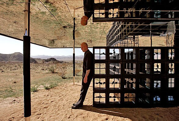 """By Barbara Thornburg Robert Stone — former punk rocker, studio artist and now architect — has built a one-bedroom retreat called Rosa Muerta on the outskirts of Joshua Tree. Chrome columns rise from the sandy desert floor to support a ceiling plane clad with mirrors. Stone left the arid landscape that surrounds the property unaltered. """"My architectural practice is more related to how artists work,"""" he says. """"I'm trying to do something amazing here. I learned as a kid doing my music that you have a right to come up with something brand new."""""""