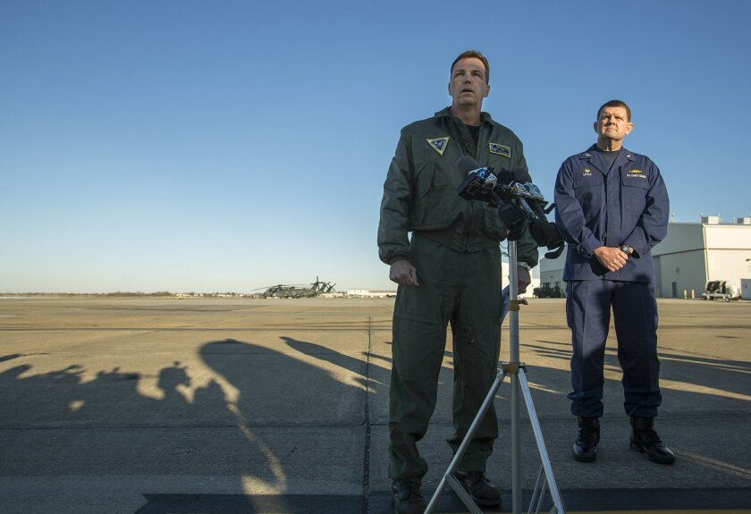 Navy Cmdr. Todd Flannery, left, Cmdr. Helicopter Sea Combat Wing Atlantic, and U.S. Coast Guard Capt. John K. Little, Sector Commander, as they answer questions about a crash of a Navy MH-53-E Sea Dragon helicopter into the Atlantic off Virginia Beach, Wednesday, Jan. 8, 2014, on the tarmac at the