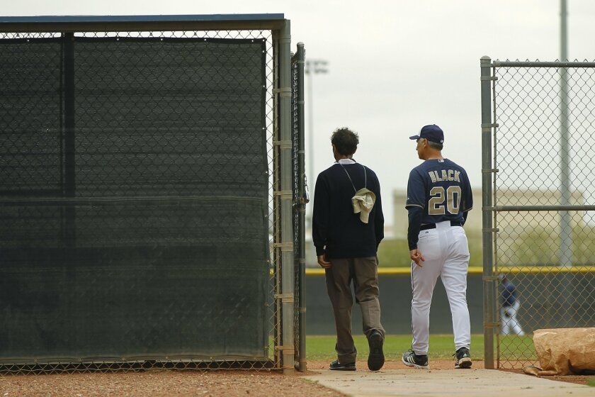 San Diego Padres General Magager A.J. Preller and Managers Bud Black talk during a spring training practice.