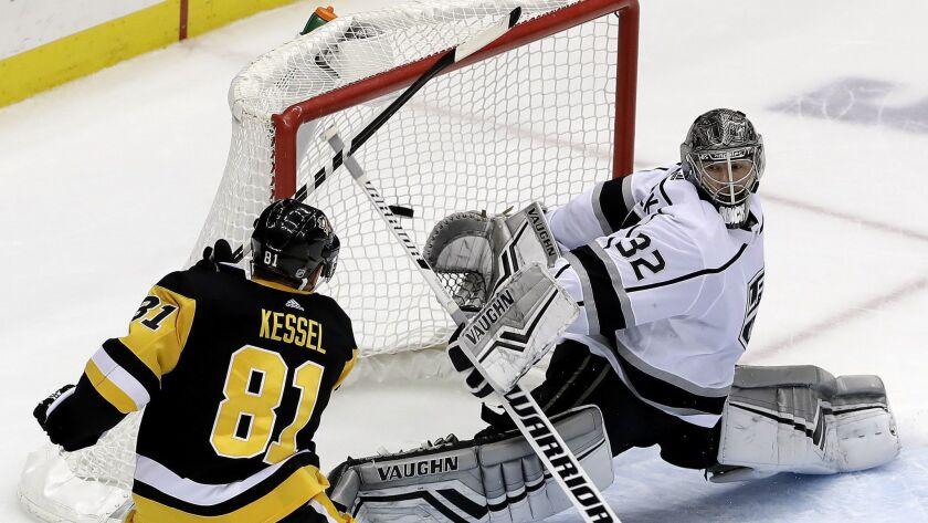Pittsburgh Penguins' Phil Kessel (81) puts the game-winning goal behind Kings goaltender Jonathan Quick (32) in overtime.