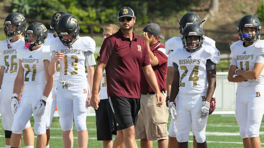 Bishop's football coach Joel Allen has guided the Knights to a 13-0 record this season.