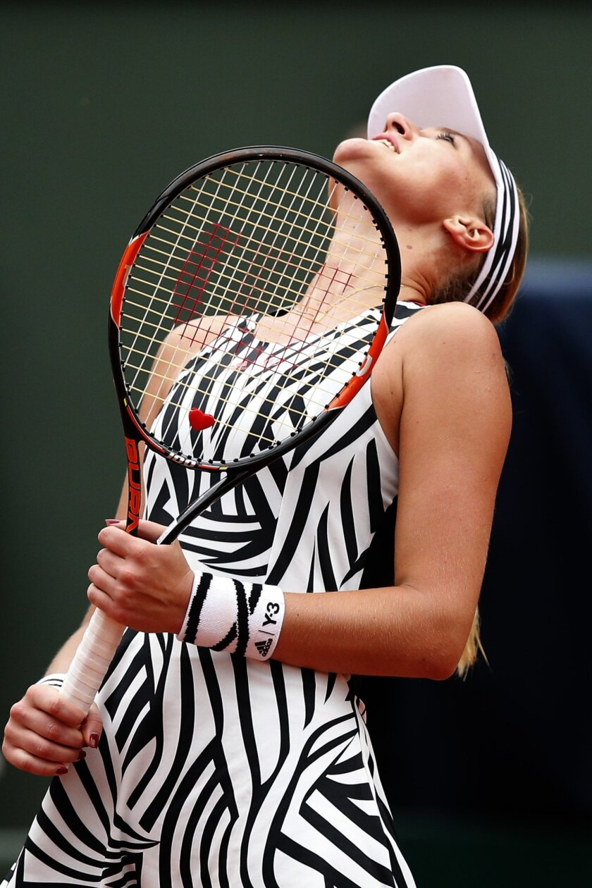 France's Kristina Mladenovic looks up to the sky after missing a return in the third round match of the French Open tennis tournament against Serena Williams of the U.S.  at the Roland Garros stadium in Paris, France, Saturday, May 28, 2016. (AP Photo/Christophe Ena)