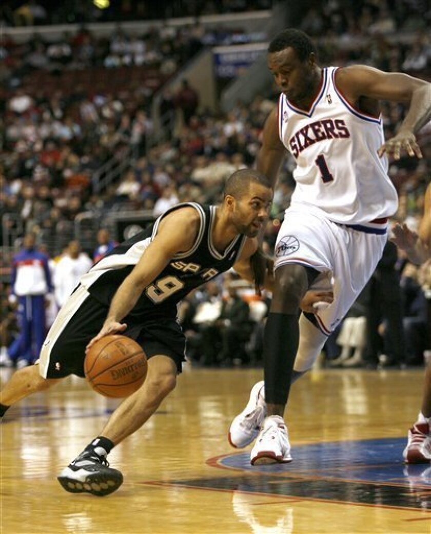 San Antonio Spurs' Tony Parker (9) drives into the lane against Philadelphia 76ers' Samuel Dalembert (1) in the first period of an NBA basketball game Friday, Jan. 16, 2009, in Philadelphia. (AP Photo/H. Rumph Jr)