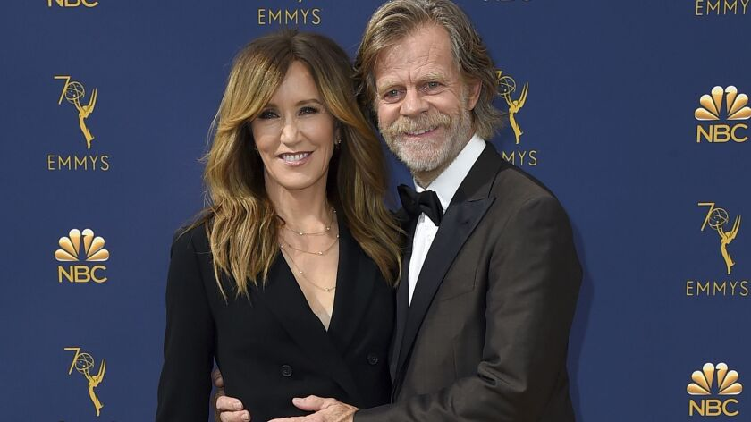 Spouses Felicity Huffman and William H. Macy arrive at the 70th Emmy Awards.