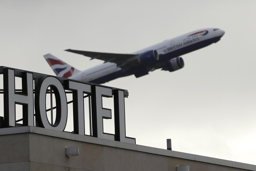 A plane takes off from Heathrow Airport in London, Friday, Feb. 5, 2021. British officials say everyone arriving in the country from coronavirus hotspots will have to spend 10 days in hotel quarantine starting Feb. 15 in a bid to stop new variants of the virus reaching the country. (AP Photo/Kirsty Wigglesworth)