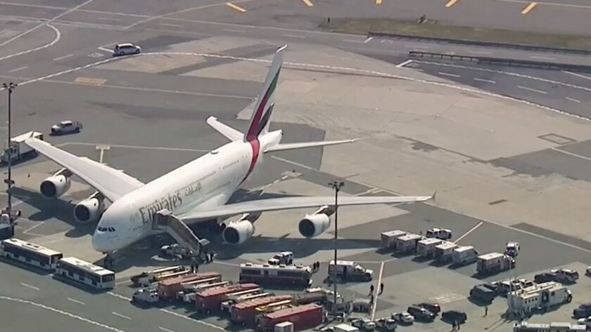 In this frame from video emergency response crews gather outside a plane at JFK Airport amid reports