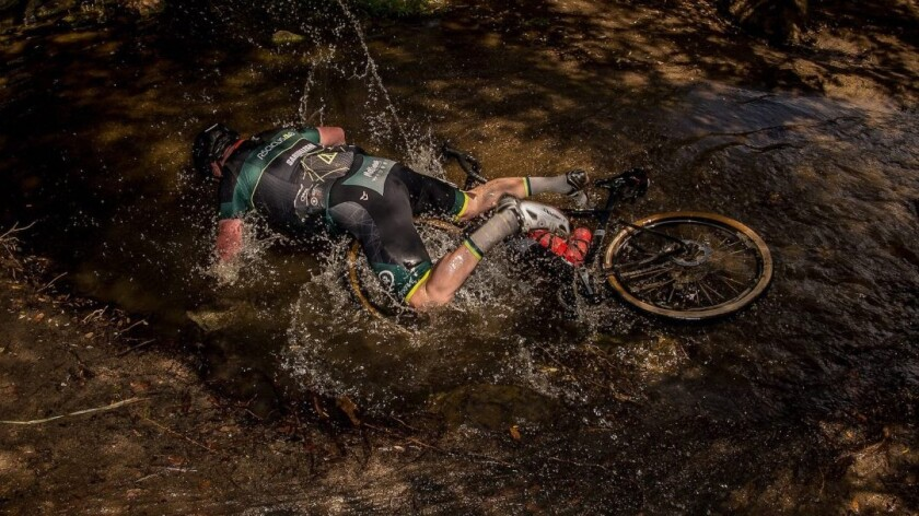 """A bike rider tumbles from his bike during the 2018 Canyon Belgian Waffle Ride that begins and ends in San Carlos. A documentary, called """"The Hell of the North County,"""" debuts next month."""