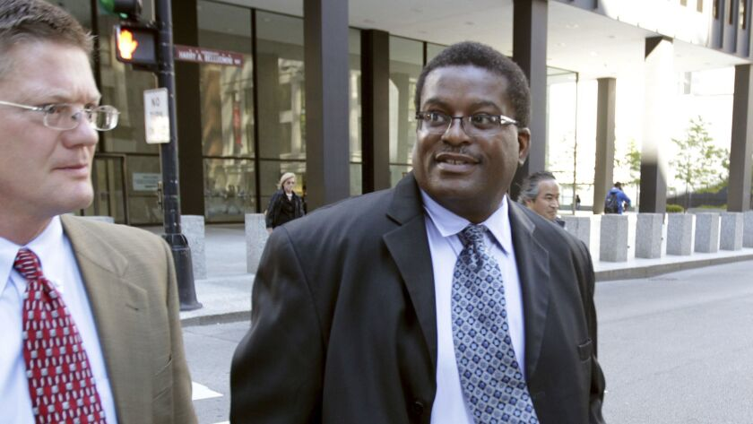 Former Chicago Police Sgt. Ronald Watts, right, leaves court after being sentenced to 22 months in prison in 2013 for stealing money from an FBI informant.