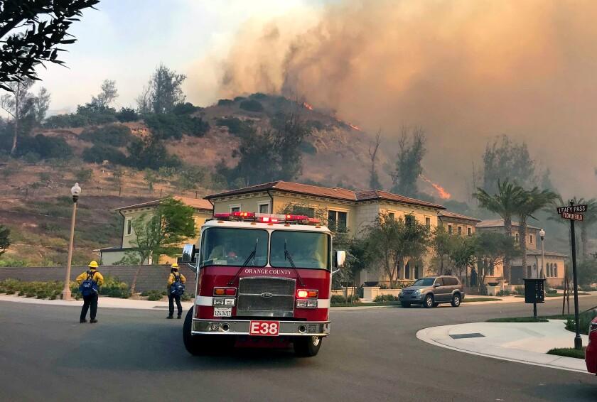 Firefighters protect an Irvine neighborhood