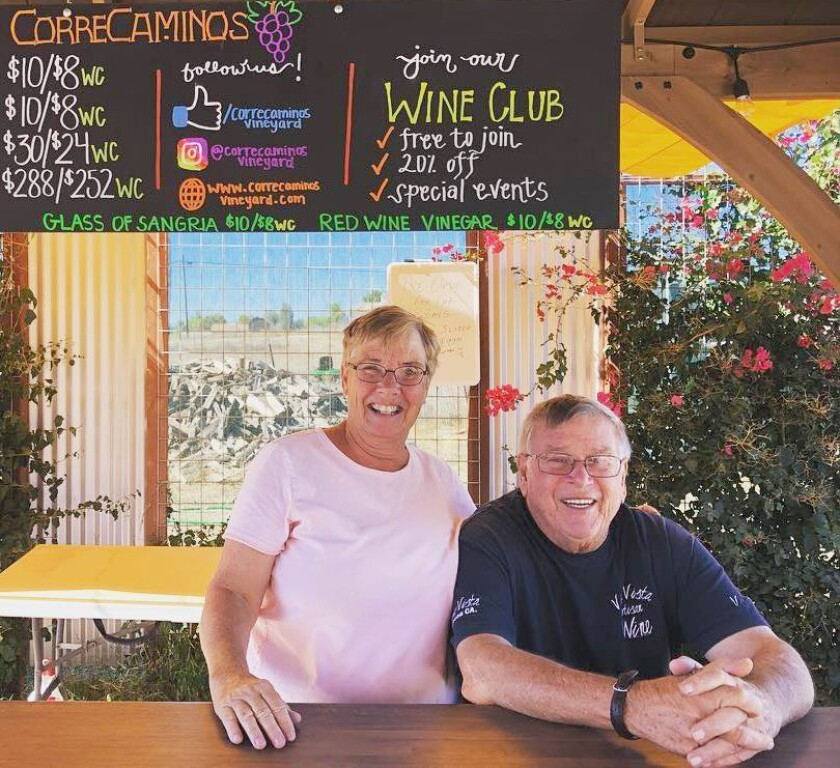 Correcaminos Vineyard Co-owners Sue and Doug Robinson offer wine on a large patio to keep customers a safe distance apart.