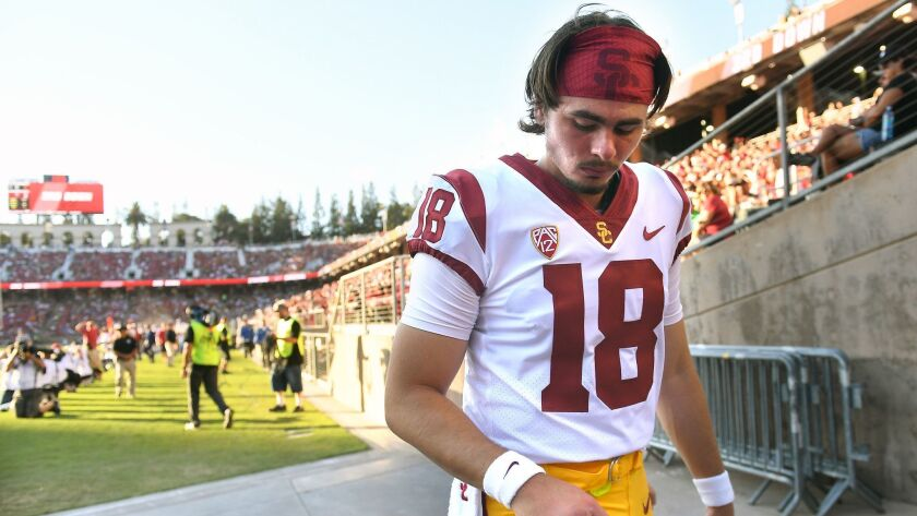 PALO ALTO, CALIFORNIA SEPTEMBER 8, 2018-USC quarterback J.T. Daniels looks at his throwing hand as h