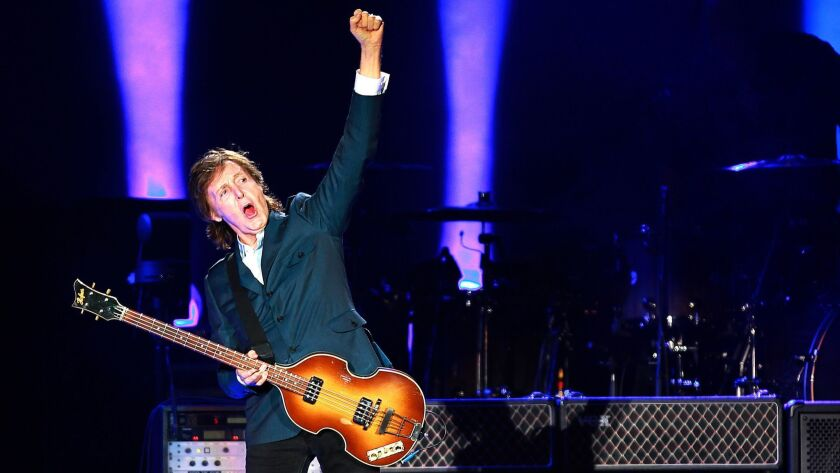 Sir Paul McCartney raises a fist tot the crowd after finishing Eight Days a Week, his opening number at Petco.