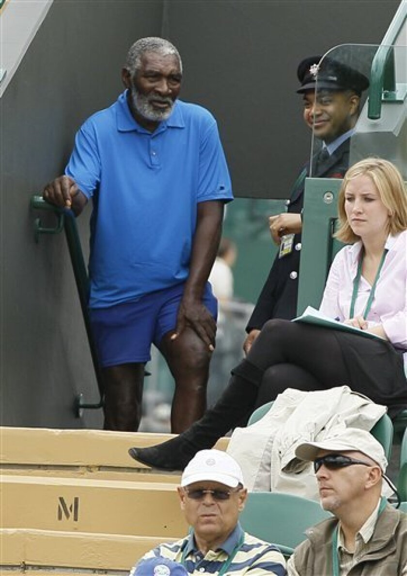 Richard Williams, father of Venus Williams of the US, watches her match against Uzbekistan's Akgul Amanmuradova at the All England Lawn Tennis Championships at Wimbledon, Monday, June 20, 2011. (AP Photo/Kirsty Wigglesworth)