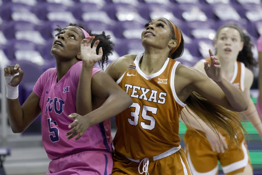 Texas forward Charli Collier battles Texas Christian forward Yummy Morris.
