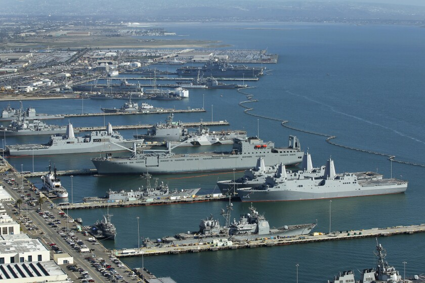 Warships are docked along San Diego Naval Base.
