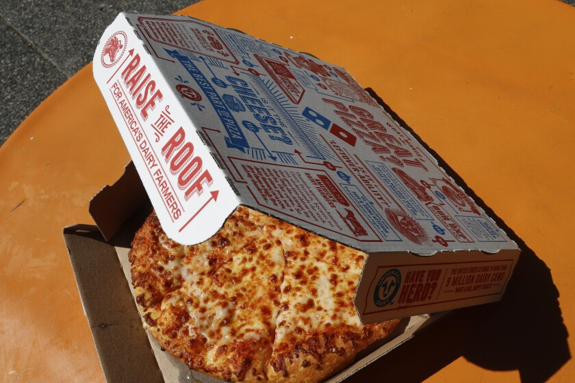 This July 15, 2019, photo shows a small Domino's pizza made in a Domino's Pizza shop in downtown Pittsburgh. Domino's Pizza Inc. reports earns Tuesday, Oct. 8. (AP Photo/Gene J. Puskar)