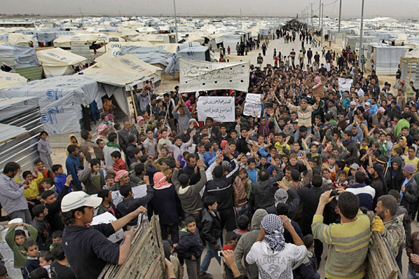 Syrian refugees take part in a demonstration this year at the Zaatari camp in Jordan, near the border with Syria.