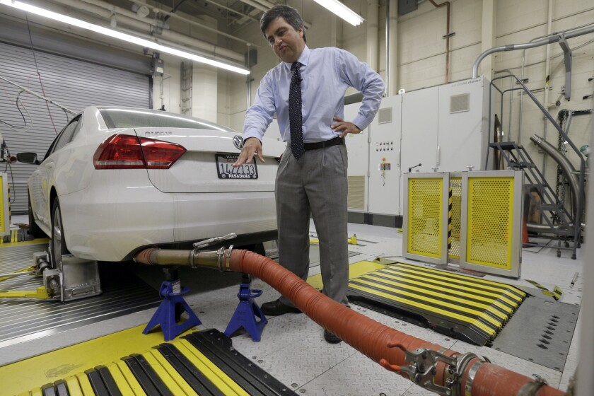 John Swanton, spokesman with the California Air Resources Board, explains how a 2013 Volkswagen Passat with a diesel engine is evaluated at the emissions test lab in El Monte, Calif., in this Sept. 30 photo.
