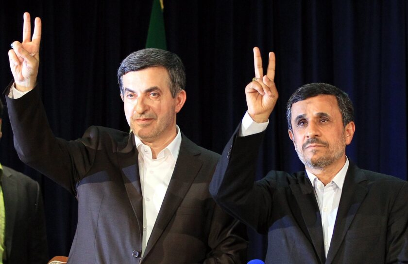 President Mahmoud Ahmadinejad, right, and his confidant, Esfandiar Rahim Mashaei, flash victory signs after Mashaei registered his candidacy earlier this month for Iran's upcoming presidential election.