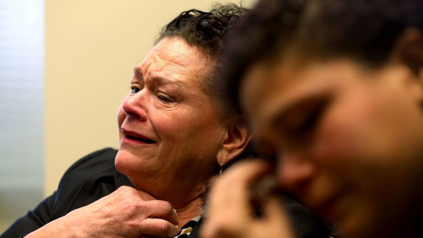 Sheri Camprone, left, is overcome with emotion as she talks about her son Brendon Glenn, 29, who was killed last year by an LAPD officer in a shooting that continues to draw headlines. At right is Glenn's sister, Brittany Glenn.