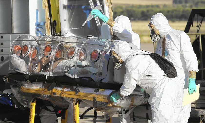 A Spanish priest who was infected with the Ebola virus while working in Liberia arrives in Spain for treatment.