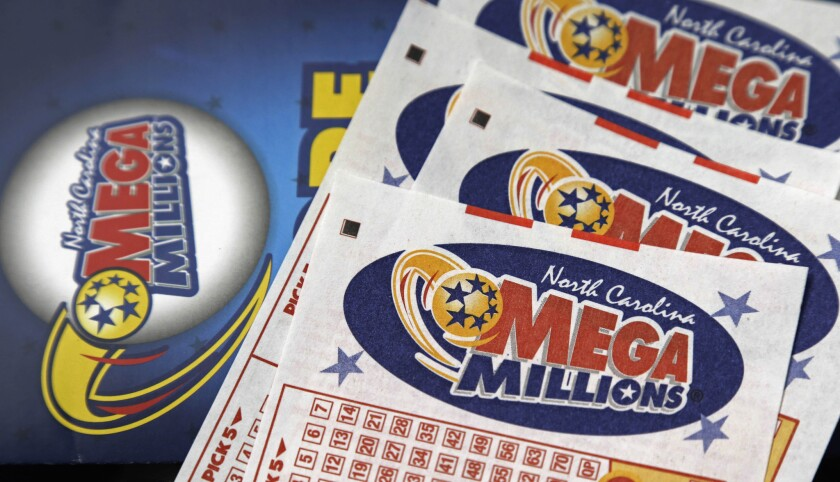FILE - This July 1, 2016, file photo shows Mega Millions lottery tickets on a counter at a Pilot tra