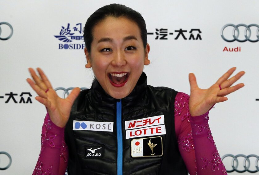 Japan's Mao Asada reacts after competing in the Ladies Short program during the ISU Grand Prix of Figure Skating held at the Capital Gymnasium in Beijing, China, Friday, Nov. 6, 2015. (AP Photo/Ng Han Guan)