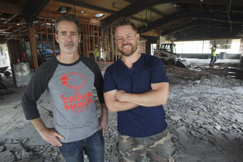 Crack Shack owner Michael Rosen, left, and chef/partner Richard Blais, stand inside what will be their new all-day chicken-and-egg restaurant, called the Crack Shack, in Encinitas.