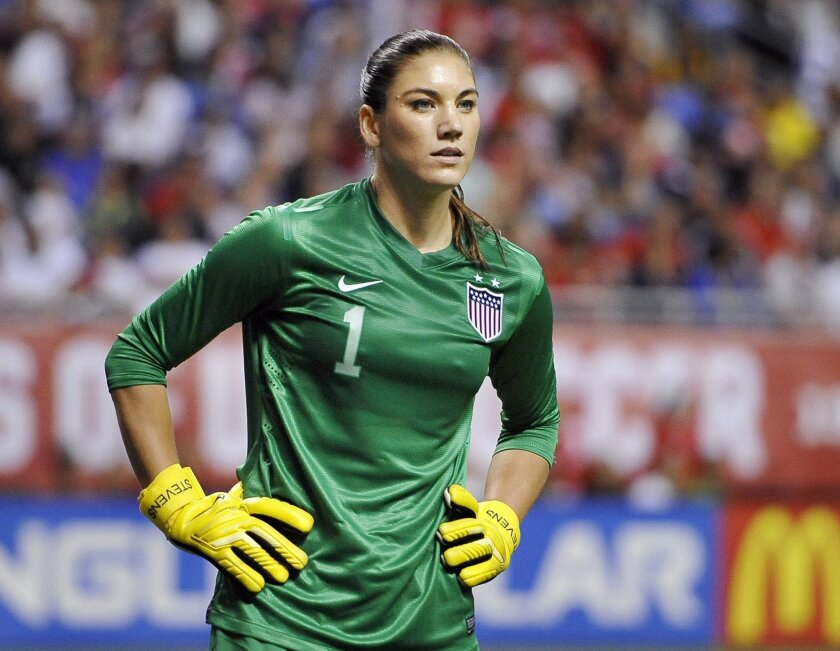 FILE - In this Oct. 20, 2013, file photo, United States goalkeeper Hope Solo pauses on the field during the second half of an international friendly women's soccer match against Australia in San Antonio. Goalkeeper Hope Solo has been suspended from the U.S. women's national team for 30 days, Wednes