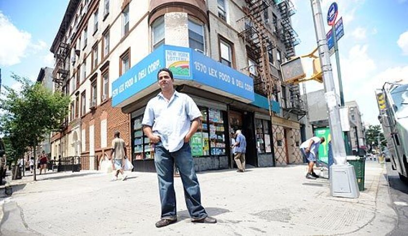 """Julio Pimentel, who owns a bodega in East Harlem, is trying to hang on even as more of the corner stores close, pressed by rising rents and food prices. """"People are looking for special prices. Sometimes bodegas can't give special prices.""""More photos >>>"""