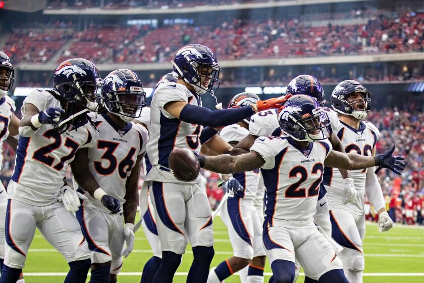 Denver Broncos cornerback Kareem Jackson celebrates an interception.