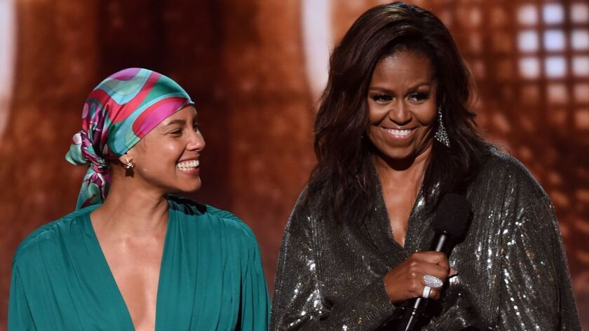 Grammy Awards host Alicia Keys appears with a surprise guest, former First Lady Michelle Obama, at Staples Center in Los Angeles on Sunday.