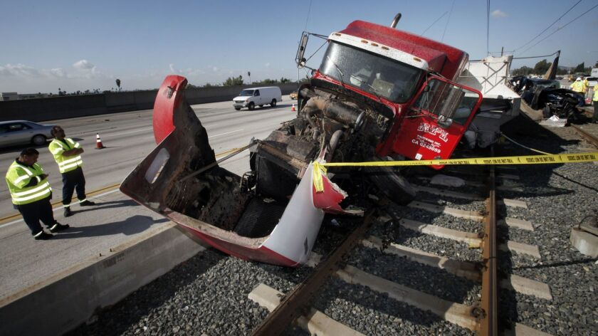 Trucks on the 210 Freeway keep crashing onto the Gold Line
